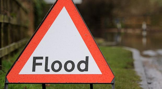 A woman is missing after heavy rain led to floods and landslides
