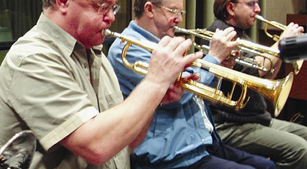 Derek Watkins, left, playing lead trumpet with the BBC Big Band at the Maida Vale Studios, London