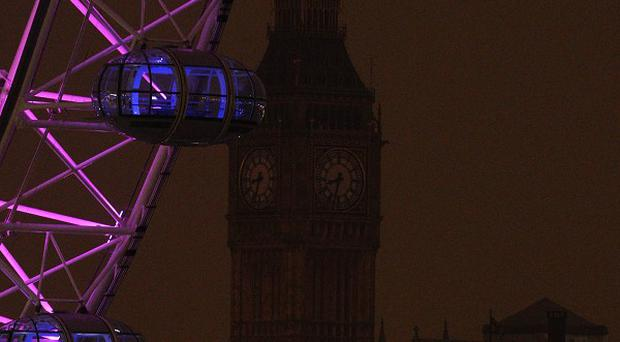 A general view of Elizabeth Tower, which houses Big Ben, in darkness as the lights were turned off to mark Earth Hour