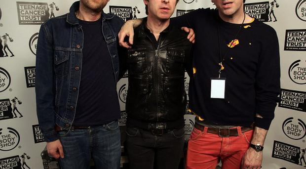 Damon Albarn, Noel Gallagher and Graham Coxon backstage during the Teenage Cancer Trust gig, at the Royal Albert Hall in London