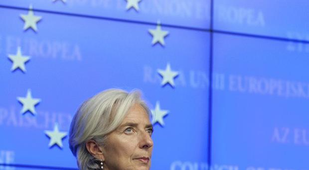 IMF managing director Christine Lagarde listens to questions during a media conference after an emergency eurogroup meeting in Brussels (AP)