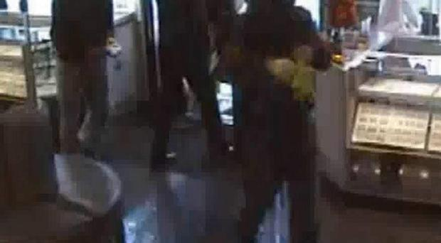 A Metropolitan Police photo shows CCTV footage of a Romanian gang robbing a jewellers in Wembley (Metropolitan Police/PA)