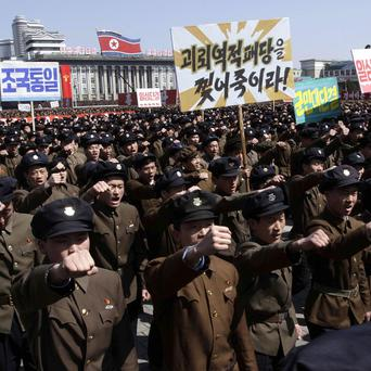North Koreans march in support of their leader Kim Jong Un's call to arms (AP)