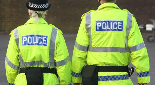 A police officer is seeking damages from a petrol station owner after she reportedly tripped on a kerb while attending a suspected break-in