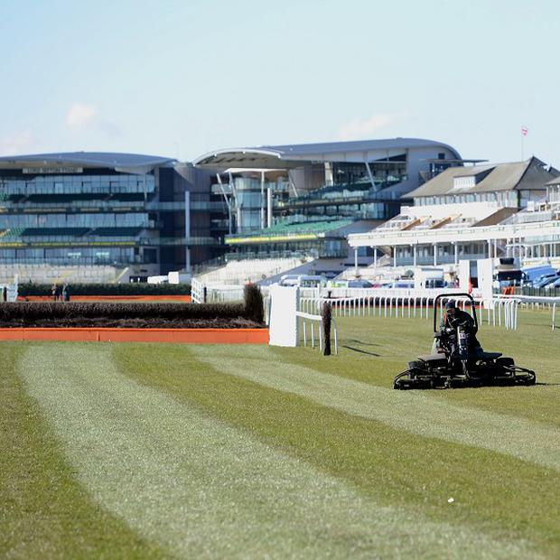 Staff prepare the track at Aintree ahead of the 2013 Grand National Meeting