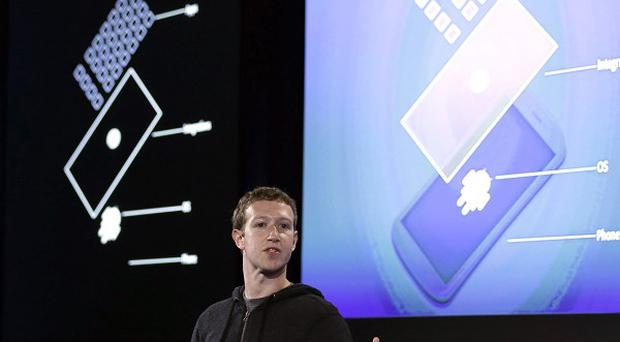 Zuckerberg said the idea behind the new Home service is to bring content right to you, rather than require people to check apps on the device (AP)
