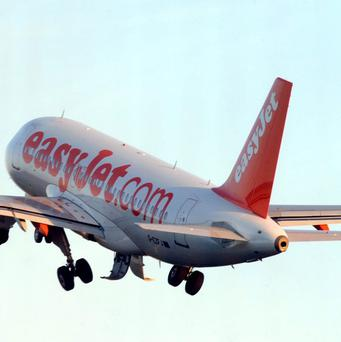 EasyJet expects to cut losses by almost half for the six months to March 31