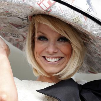 Singer Liz McClarnon sported a newspaper hat for Ladies' Day at Aintree