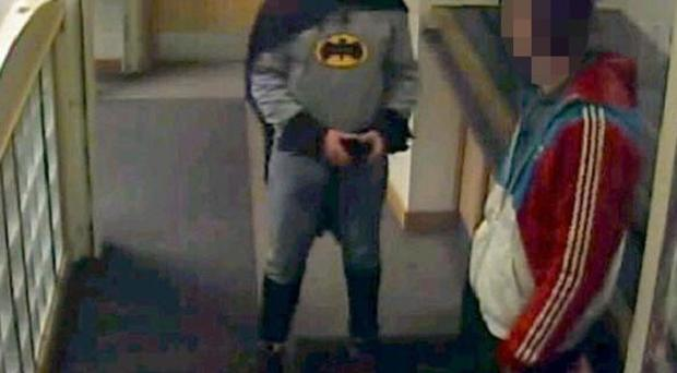 Stan Worby, dressed as Batman, walked into a police station in Bradford and handed over Daniel Frayne (West Yorkshire Police/PA)