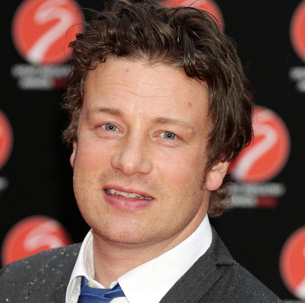 Jamie Oliver says his new book will help people get kitchen-smart and smash the recession