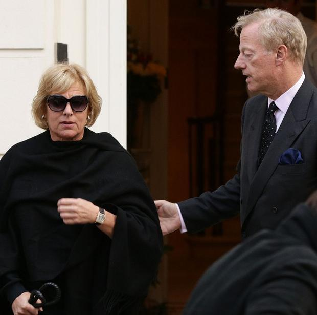 Mark Thatcher greets his sister Carol as she arrives at their mother's London home