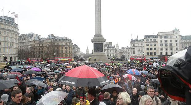 People attend a Thatcher's dead 'party' organised via Facebook, in Trafalgar Square