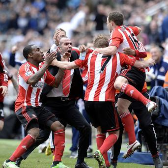 Sunderland manager Paolo Di Canio (second left) celebrates with his players after his side's third goal against Newcastle United