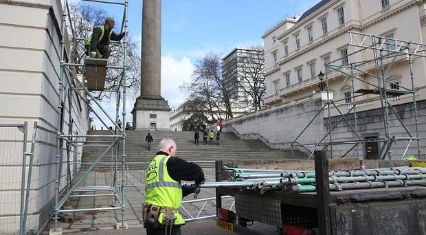 Scaffolding being put up along The Mall ahead of the 2013 London Marathon