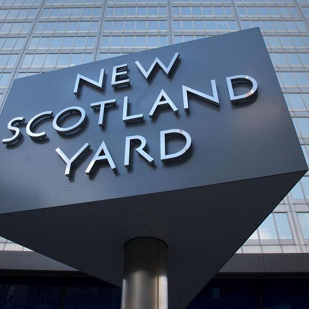 Detectives from Scotland Yard have arrested a former Surrey police officer in connection with the investigation into alleged payments to public officials