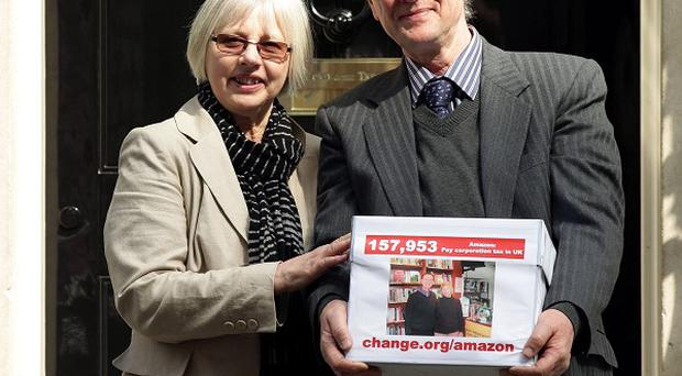 Frances and Keith Smith hand in a petition signed by more than 150,000 people in Downing Street