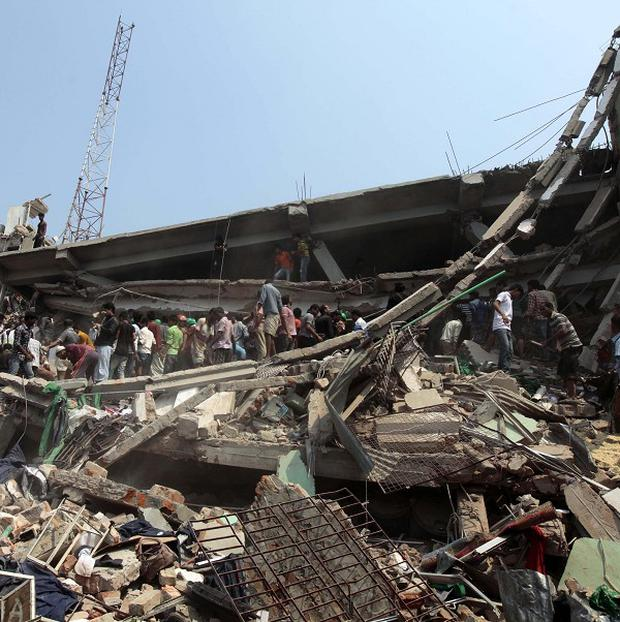 People look for survivors after an eight-story building with a floor occupied by Primark collapsed (AP)