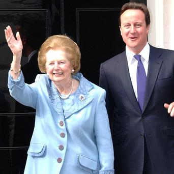 David Cameron, pictured here with the late Margaret Thatcher, has denied being a Thatcherite