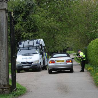 Police at the entrance to Down Hall Country House Hotel in Hatfield Heath, Essex