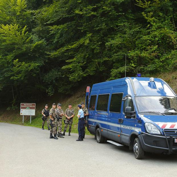 French police guard the road to the murder scene at Cheverlaine near Annecy in the Haute-Savoie region of south-eastern France