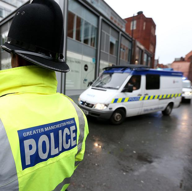 Police in Salford are hunting two men who fled from a prison van