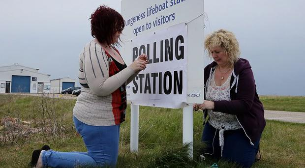 Poll Clerk Amelia Hetterley and Presiding Officer Sue Bunney set up their polling station at Dungeness Lifeboat Station in Dungeness, Kent