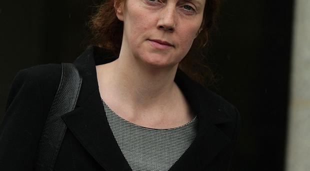 Rebekah Brooks's bodyguard is to be charged with conspiring to hide computers from police investigating phone hacking