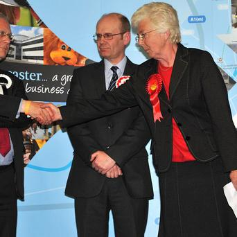 Labour candidate Ros Jones, right, is congratulated by outgoing mayor Peter Davies after she was voted Mayor of Doncaster