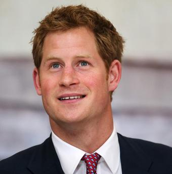 Prince Harry tours an anti-landmine photography exhibition by The Halo Trust charity in Washington, DC
