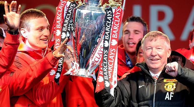Manchester United players and manager Sir Alex Ferguson (right) celebrate on stage in Albert Square