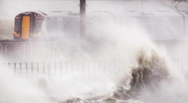 As rain lashed across much of the country, a deep low pressure system brought gusty winds