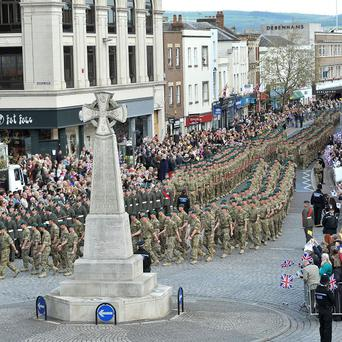 The Royal Marines of 40 Commando homecoming parade marches past the war memorial through Taunton, to mark their return from Afghanistan