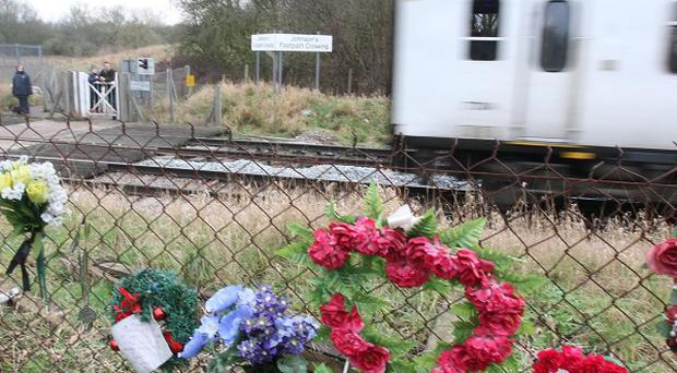 Flowers left for Katie Littlewood after she died at the Johnson's Footpath crossing in Bishop's Stortford, Hertfordshire