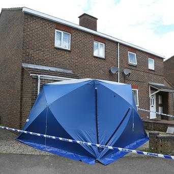 Police at the scene in Bicester, Oxfordshire, where the body of a two-year-old child was found