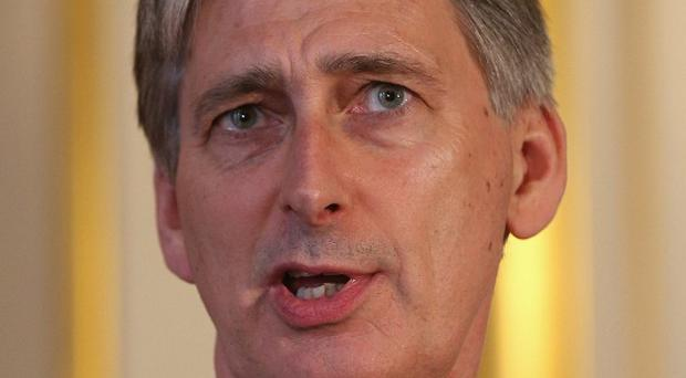 Philip Hammond said the introduction of civil partnerships had dealt with the 'very real disadvantage' gay couples faced in the past