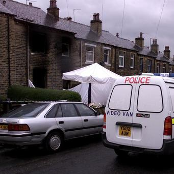 Five children and three adults died in the house fire in the Birkby area of Huddersfield in 2002