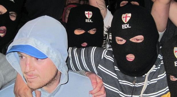 English Defence League leader Tommy Robinson, left, with supporters outside The Queens Arms pub in Woolwich