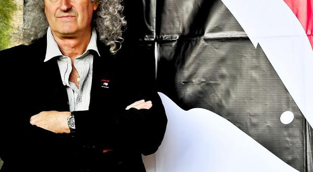 Queen guitarist Brian May will lead a rally against planned badger culls