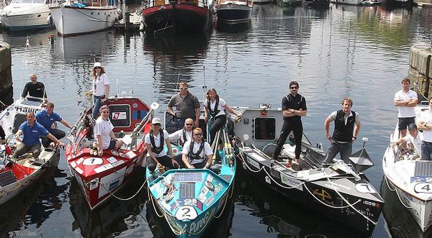 Competitors in the GB Row 2013 race show off their boats