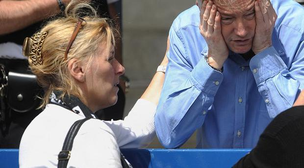 Steven and Lynette Williams, left, parents of Georgia Williams who is believed to have been murdered, show their emotion at a tribute to their daughter at Wellington AFC football ground
