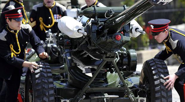 Members of the Honourable Artillery Company ready a gun prior to firing a 62 round Royal Salute