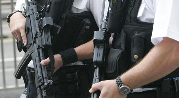 Firearms officers surrounded the flats in Coventry after a man was found with gunshot injuries