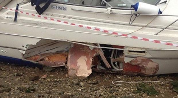 Photo of a 27ft cruiser called Sea Eagle with a significant hole in her hull caused by a collision with a buoy