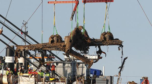 Lifting equipment raises a Dornier bomber from the English Channel