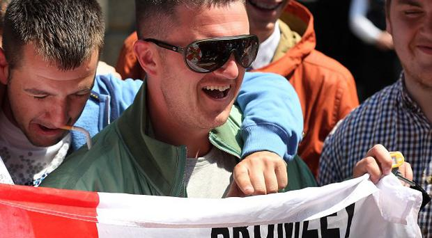 English Defence League leader Tommy Robinson denied his group was behind a blaze at an Islamic centre in London