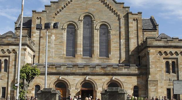 Mourners arrive at St Mirin's Cathedral in Paisley, Scotland, for the funeral of Margaret McDonough and her daughter Nicola