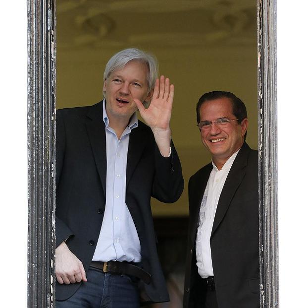 WikiLeaks founder Julian Assange appears with Ecuador's Foreign Minister Ricardo Patino on the balcony of the Ecuadorian Embassy in London (AP)