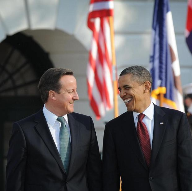 US President Barack Obama, pictured with David Cameron last year, has arrived in Belfast for the G8 summit