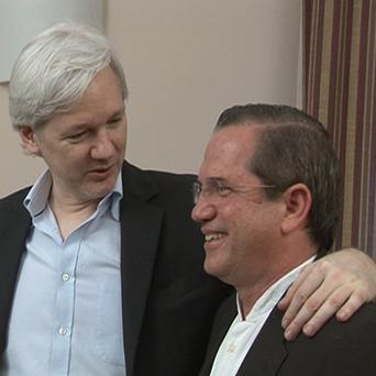WikiLeaks founder Julian Assange with Ecuador's foreign minister Ricardo Patino inside the Ecuadorian embassy in London (AP)