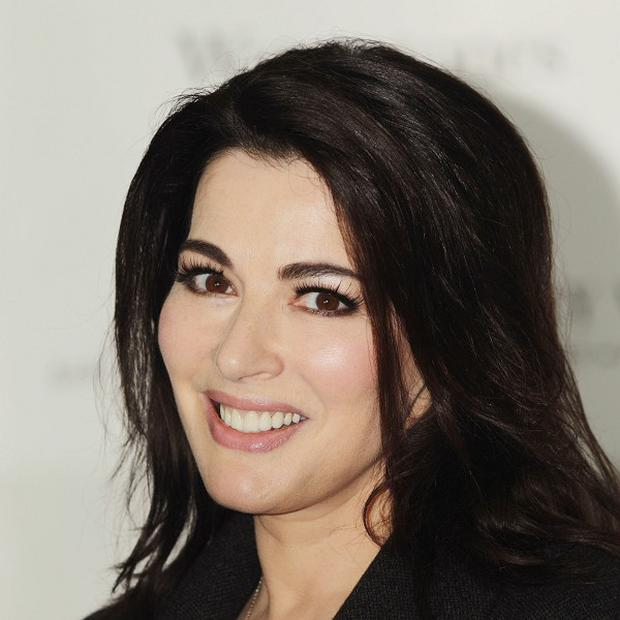 Images printed in the media appear to show Charles Saatchi grabbing his wife Nigella Lawson's throat